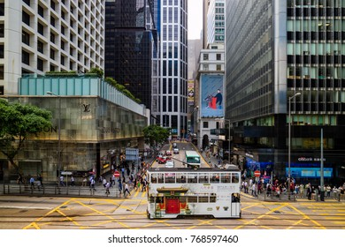 CENTRAL, HONG KONG - SEPTEMBER 22, 2017 : Tram transportation, vehicle traffic, people and building in Central Hong Kong
