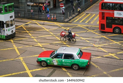 Central, Hong Kong-14th March 2019: Various transportation mode or vehicles on the street, i.e., tram, bus, bicycle and taxi.