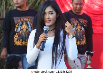 Central Java - May 25, 2018: illustrative editorial photo-beautiful asian girl master of ceremonies in bird race, Indonesia