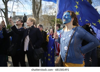 Central London, Uk. 25 March, 2017. A woman holds an EU flag while listening to speeches in support of the EU at Westminster