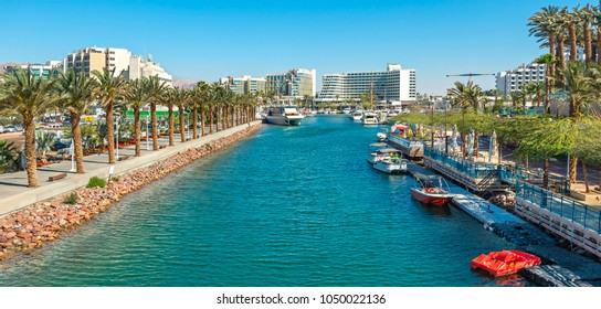 Central marina and promenade in Eilat city. This serene location is a very popular tropical getaway for Israeli and European tourists.