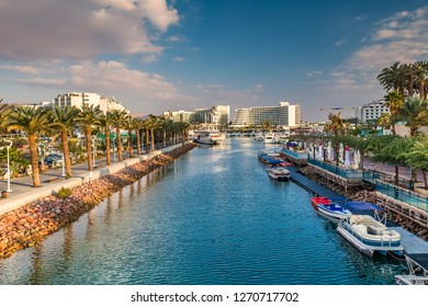 Central marine and promenade with pleasure boats,  surrounding hotels, market and shopping places in Eilat - famous resort and recreational city in Israel and Middle East