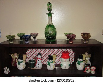 Central NJ/USA: December 5, 2015: A bookcase is adorned with snowmen and other seasonal Yuletide decorations.