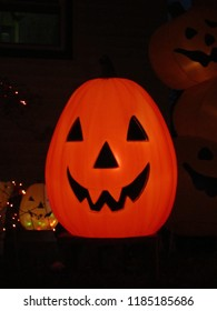 Central NJ/USA - October 1, 2016: A large, glowing vintage Halloween Jack O'Lantern sits on a front lawn.