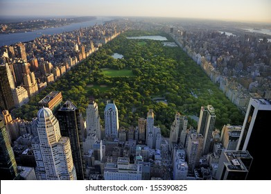 Central Park aerial view, Manhattan, New York; Park is surrounded by skyscraper  - Shutterstock ID 155390825