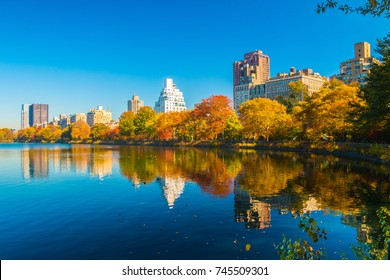 Central Park lake with autumn trees and skyscrapers