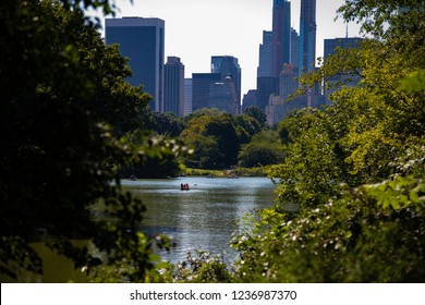 central park lake with nyc buildings in background
