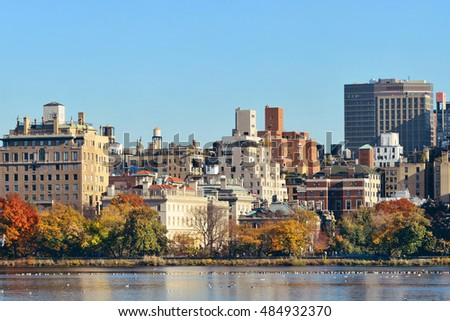 Central park Manhattan east side luxury building over lake in Autumn in New York City.