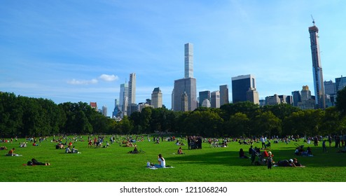 Central Park/ Manhattan/New York City/USA - 30 September 2018: New York City Manhattan skyline panorama viewed from Central Park with cloud and blue sky.  Autumn and buildings in midtown Manhattan.