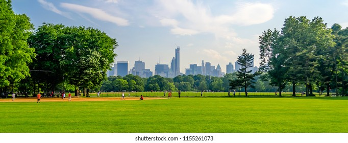 Central Park on a sunny day and a beautiful contrast with skyscrapers and buildings, Manhattan, New York City, USA