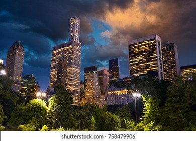 Central Park and skyscrapers at dusk in New York
