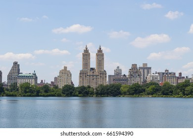Central Park West skyline and the Jacqueline Kennedy Reservoir in New York City with apartment skyscrapers over lake in midtown Manhattan