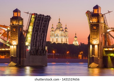 The central part of the divorced Peter the Great Bridge (Bolsheokhtinsky) and the Smolny Cathedral on a white night. St. Petersburg