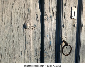 Central part of an old wooden door of an agricultural village in the middle of the Iberian Peninsula, Europe.