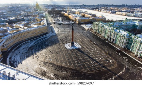 The central part of the southern facade of the Winter Palace and the Alexander Column are on wintry Palace Square. Aerial view from drone. St. Petersburg, Russia