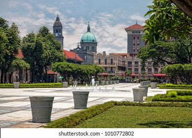 Central Plaza with View of Historic Colonial Skyline. No People. Blue Sky with Clouds. (Manila, Philippines).