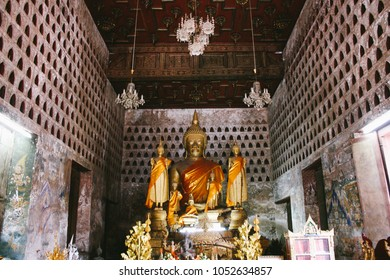 The central praying hall of Wat Si Saket, the oldest Buddhist temple in Vientiane, Laos, with hundreds of Buddha images housed in wall niches and beautiful fading murals about the life of Buddha.