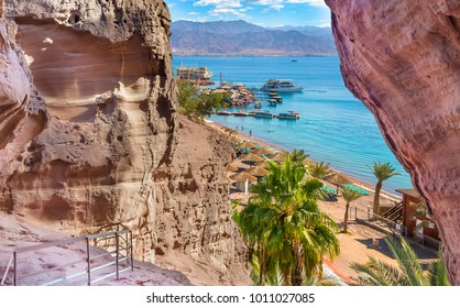 Central public beach in Eilat seen trough the arches of Timna park that is located 25 km north of Eilat