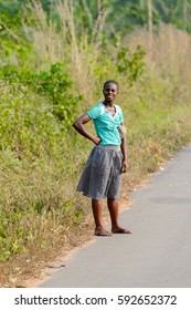 CENTRAL REGION, GHANA - Jan 17, 2017: Unidentified Ghanaian woman stands beside the road in local village. People of Ghana suffer of poverty due to the bad economy