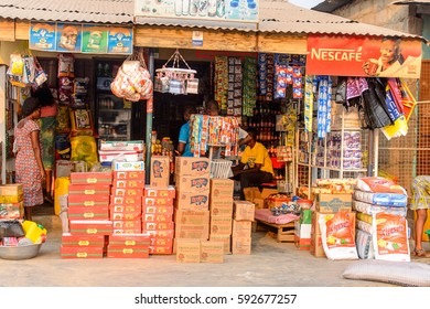 CENTRAL REGION, GHANA - Jan 17, 2017: Unidentified Ghanaian people choose goods to buy in local village. People of Ghana suffer  poverty due to the bad economy
