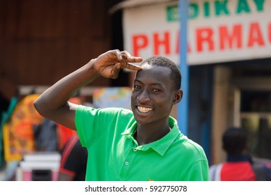 CENTRAL REGION, GHANA - Jan 17, 2017: Unidentified Ghanaian man in green shirt smiles in local village. People of Ghana suffer of poverty due to the bad economy