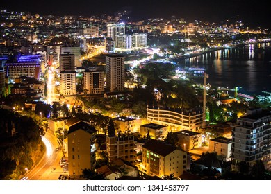 Central road is along the sea coast, through the modern part of the city of Budva. Aerial view at night time. Montenegro, Europe