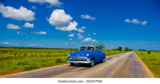 CENTRAL ROAD, CUBA - SEPTEMBER 06, 2015: American Oldtimer in the rural road system used for transportation