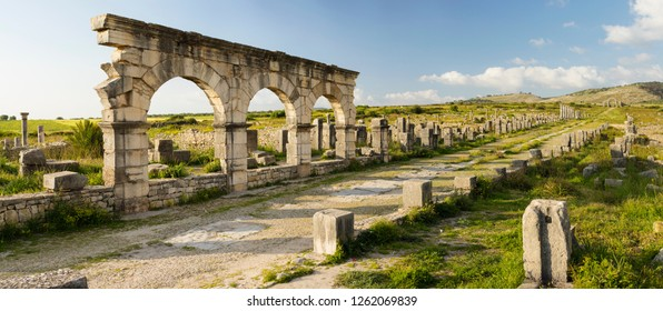 central street with giant arch in antique roman city Volubilis in Morocco