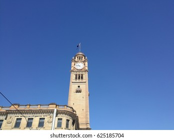 the central train station historical clock in Syndey with clear blue sky