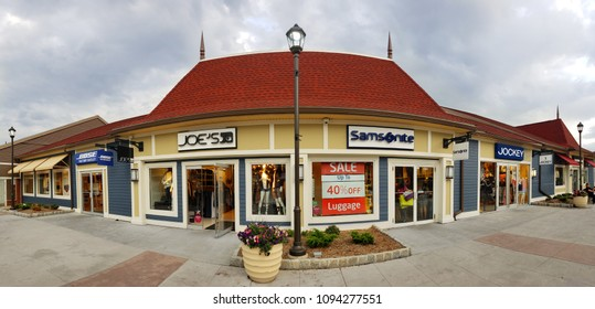 CENTRAL VALLEY, NY - MAY 4, 2018: Store panorama in Woodbury Common Premium Outlet mall. The center is owned by Premium Outlets, a subsidiary of Simon Property Group.