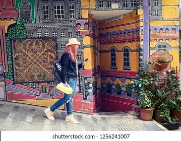CENTRAL-HONG KONG -DECEMBER-7-2018:People walking in front of wall Which famous painting on wall in Hong Kong