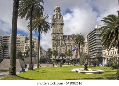 centrally located salvo palace (palacio salvo) seen from plaza independencia (independence square) surrounded with palms and lawns. montevideo, uruguay
