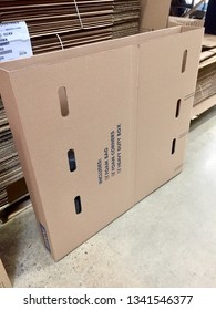 Centreville, Virginia- March 10, 2019: The inside half of a large cardboard storage box designed for televisions, artwork and mirrors on sale at The Home Depot store.