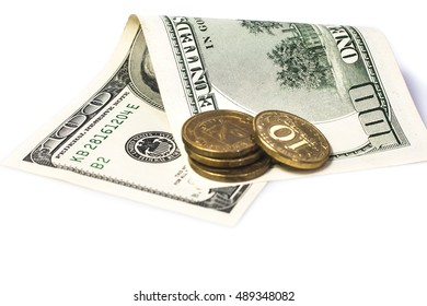 cents and paper hundred-dollar bills white background