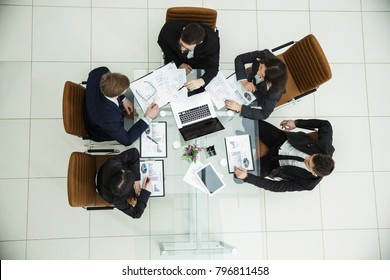 CEO and the business team at a working meeting