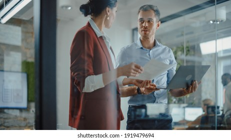CEO and Chief Executive Talking About Company Business Growth, Consult Data Analysis and Use Laptop Computer. Two Professionals Discussing Revenue Increase, Market Disruption, Planning Strategy