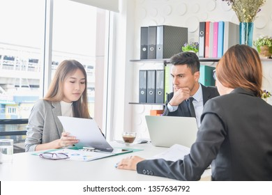 CEO or chief financial officer sees financial summary reports with his secretary team or discusses goal future project business plan about future growth and improvements