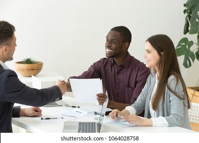 Ceo handshaking appreciating african project team leader motivating promoting for good results, satisfied diverse partners shaking hands after successful group negotiations promising good contract