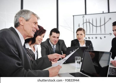 CEO reading report at business meeting