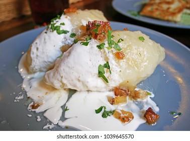 Cepelinai, traditional Lithuanian dish of stuffed potato dumplings