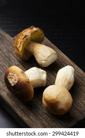 Ceps on wooden cutting board