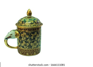 Ceramic art in the age-old pattern of Thailand is handmade. Image of cup with lid, white background