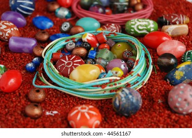 ceramic beads with leather ropes on red sand