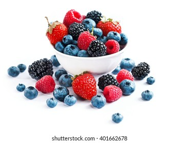 Ceramic bowl with assortment berries (blueberries, strawberries and blackberries) on white background. Close up, high resolution product. Harvest Concept