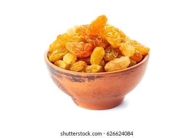 Ceramic bowl with golden raisins on white