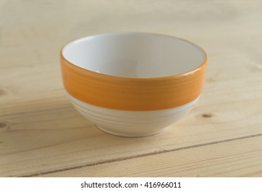 ceramic bowl on wooden table