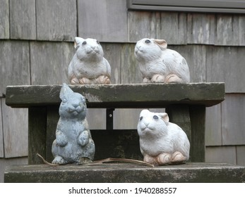 Ceramic Bunny Garden Statues On a Ledge During Winter