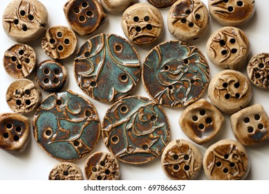 Ceramic buttons glazed with blue rutile