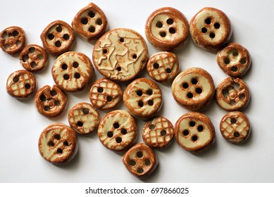 Ceramic buttons glazed with buff clay