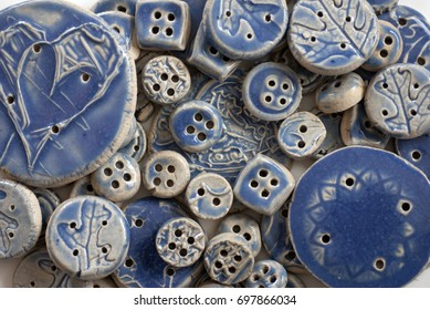 Ceramic buttons glazed with grape fizz